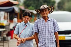 Father & Daughter, Riohacha Colombia (AdamCohn) Tags: adamcohn colombia riohacha cowboyhat hat man streetphotography woman wwwadamcohncom