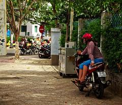 Taking a short rest (atvstd) Tags: vietnam nha trang outdoor street pavement moto bike people different nikon d5100 spring rest city