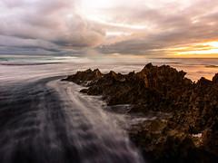 Wetting feet at Rye (Derek Midgley) Tags: d756858 rye number16 beach rocks sunset evening long exposure