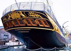 The Stern of SS Great Britain. (rustyruth1959) Tags: nikon nikond3200 tamron16300mm bristol uk ssgreatbritain ship vessel museum stern hull windows outdoor deck lions gold railings rigging dock drydock dockyard flags emblem