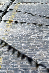 cobbles with shadows of celebration flags (Mikel Martnez de Osaba) Tags: birthday street carnival shadow party festival festive fun happy triangle anniversary decorative background stripes flag decoration blowing line celebration sidewalk event string hanging tied cobbles flap enjoyment triangular bunting pavemente