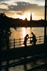 Watching the flood, a series (habeebee) Tags: light sunset people sunlight reflection tower church water silhouette june clouds fence river twilight couple hungary view budapest watching rails ripples spectators duna sunrays curiosity danube floods outing onlookers flooded magyarorszg tramrails 2013 rvz