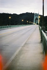 St. John's Bridge (idintify media) Tags: park street blue oregon forest portland lights evening cathedral northwest dusk walk pedestrian sidewalk evergreen hour stjohnsbridge shellno