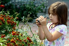 Little photographer. (halina.reshetova) Tags: camera flowers red summer plants brown white green nature girl yellow canon hair mantis photography photo hands photographer blossom picture august photograph bloom flowering summertime curiosity crimea florescence littlephotographer canoneos1000d 08092013 mezhvodnoe