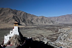 """Beautiful in a stunning location - Yumbulakang Palace, """"The First House of Tibet"""", is an ancient palace in the Yarlung Valley, Ndong County in the vicinity of Tsetang. (eriktorner) Tags: sun moon temple im symbol top stupa buddhist january buddhism palace tibet kings tibetan chorten civilisation cradle tempel yarlung firsthouse lagang lakang yumbulakang symboler yumbu yarlungriver imsoir yarlungdynasty tibetanempire jumbulakang yumbulagan"""