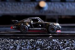 Black Porsche (Ben Hutson) Tags: black up car canon toy close side porsche worn scratched grimsby dented childhoodmemories 100d