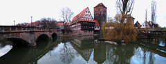 Student Residence between two Bridges in Nuremberg, Germany (Batikart) Tags: city travel trees winter vacation sky urban panorama plants holiday building tower monument water stone architecture canon reflections river germany geotagged outdoors deutschland bavaria wooden student wasser europa europe day arch stitch pov urlaub nuremberg perspective citylife bridges himmel historic stadt lanterns architektur february residence dormitory ursula brcke fluss turm oldtown baum gebude halftimbered nrnberg februar studentenwohnheim sander g11 laternen 2014 pegnitz historisch winestore spiegelungen holzbrcke weinstadel 100faves maxbrcke 200faves 300faves batikart henkersteg hangmansbridge canonpowershotg11