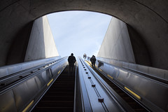 Escalator at Capitol South Metro Station, Washington, DC (dckellyphoto) Tags: washingtondc districtofcolumbia metro wmata dc escalator lookingup sky underground portal exit subway subwaystation capitolsouth washingtonmetro architecture concrete metal person people clouds walking climbing wideangle