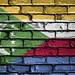 National Flag of Comoros on a Brick Wall