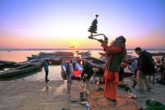 A sadhu performing Ganga Arthi at Dashashwamedh Ghat, Varanasi (AgniMax) Tags: sunrise varanasi banaras hindu aarthi aarathi arti boat ganga ganges pooja agni sadhu uttarpradesh india incredibleindia street
