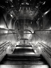 Heading To The Platform (updownmo) Tags: blackandwhite staircase reflection architecture stairways nightlight nightphotograph london canningtown londonunderground