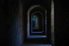 The Corridor (A B Cosgrove) Tags: spain italica lowlight stone shadow corridor path