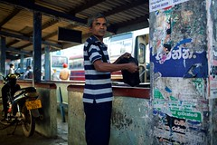 Morning @ the Bus Station (alisdair jones) Tags: ef35mmf14lusm man street walls bus station anuradhapura srilanka