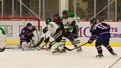 In tight (R.A. Killmer) Tags: sru ice hockey skate skill stick hits shot puck acha green white college competition gritty