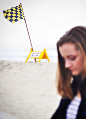 Checkered Flag (iamamylou) Tags: flag yellowandblack checkered sign ocean beach waves sand yellow color wind blowing pacificbeach girl youth teen blur outside outdoors