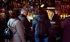 The Temple Bar (Owen J Fitzpatrick) Tags: ojf people photography nikon fitzpatrick owen j joe pretty pavement chasing d3100 ireland editorial use only ojfitzpatrick eire dublin republic city tamron beautiful beauty attractive female lady temple bar pub public house alcohol pint drink barman bottle harpbartop guinness spirits whiskey watering hole candid unposed candidphoto candidphotography candidportrait natural realism documentary photojournalism life