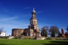 St Chad's and clock tower (Sundornvic) Tags: church shrewsbury shropshire stchads town centre quarry park grass trees blue sky clouds light tower cross
