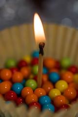 Happy 10 Years Macro Mondays! (NedraI) Tags: candies flame macromondays cupcakeliner celebration candy macro match happy10years