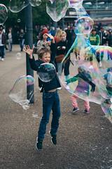 Southbank walk, London, April 2017 (Etienne Gaboreau) Tags: southbank london londres bubbles streetphotography people portrait bubble kids children canon 5d markiii thames tamise river rivière uk united kingdom eye londoneye