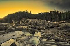 Elbow Falls Sunrise (John Andersen (JPAndersen images)) Tags: alberta borderfx canada clouds dawn elbowfalls kananaskis mountains reflections river sky spring trees