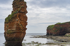 Dramatic beach view (LeePotter74) Tags: atmospheric bay beach calm cliffs coastline ladram peaceful picturesque red rockpools water waves weathered