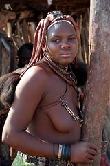 Himba girl - Himba village in Kaokoland, Namibia. (One more shot Rog) Tags: himba tribe tribes tribal himbavillage himbawoman himbagirls himbapeople etosha opuwo kaokoland namibiantribes onemoreshotrog remote traditional brades nikon7100 safari africantribes african africa rogersargentwildlifephotography