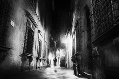 The cyclist (www.streetphotography-berlin.com) Tags: street streetphotography streetlife cyclist alone night light shadow lucca tuscany italy blackandwhite blackwhite impressionism impressionist