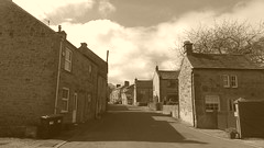Main Rd, Eyam   -   April 2017 (dave_attrill) Tags: main road rd street houses cottages sepia monchrome eyam derbyshire peak district hope valley 11th century village bubonic plague breakout 1665 rev william mompessom anglo saxon roman lead mining 260 deaths architecture outdoor stonework historic mid 17th cottage april 2017 national park white mines domesday book