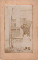 Edwardian basket carrier (c.1905) (pellethepoet) Tags: photograph portrait outdoor labourer man baskets garden backyard