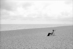 Life on a British beach in summer (RoryO'Bryen) Tags: beach playa praia plage british seaside coast summer blackandwhite leicam leicasummiluxm35mmf14asph 35mmsummiluxmasph leicamp rangefinder copyrightroryobryen roryobryen messsucher people film ilfordpanf50 iso50 suffolk deckchair aldeburgh waterislife lifeiswater elaguaesvida somosagua sinaguanohayvida withoutwaterthereisnolife wearewater