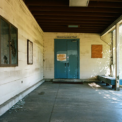 chapel (John Piazza) Tags: abandoned broken church glass architecture analog closed catholic military faith religion ruin corridor entrance chapel doorway 400 boardedup alameda contemplative portra locked hopper monastic rolleicord jeffwall blessedsacramentchapel johnpiazza