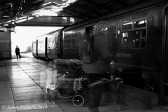 Begining of a Journey (James Etchells) Tags: light people urban white black texture college station bike speed train dark photography town waiting long exposure industrial slow ghost group perspective smooth platform bikes norton passengers shutter passenger rough ghostly groups speeds exposures radstock frome