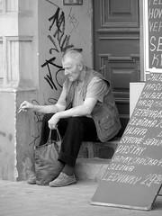 Smoking Man Sitting next to the Butcher Shop (Kojotisko) Tags: street man brno cc creativecommons czechrepublic streetphoto smoker gamewinner favescontestwinner achallengeforyou thechallengefactory faveswinner yourockwinner yourockunanimous gamex2winner gamex3sweepwinner
