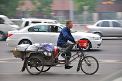 The old and the new (jeremyhughes) Tags: china street urban motion contrast speed work movement nikon tricycle working beijing cargo bmw trike nikkor panning oldvsnew modernisation oldandnew pedalpower 18200mmf3556gvr cargotrike d300s workingtrike