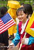 Tibetan girl  in traditional dress with Flags (Remsberg Photos) Tags: usa buddhist culture maryland americanflag monk flags um leader lama tibetan collegepark universityofmaryland tibetangirl