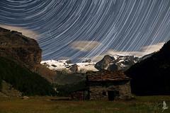 Notte in piana (_milo_) Tags: sky italy snow night clouds montagne canon stars eos italia nuvole natura cielo neve notte startrails manfrotto champoluc stelle piana casetta 18135 treppiede verra 60d