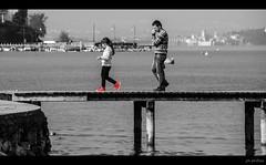Follow the Red Shoes (PhilFree - http://goo.gl/S3zE10) Tags: family red sea people italy white lake black water girl del walking lago kid dock shoes garda italia child walk father son e di bianco nero sirmione peschiera