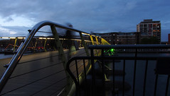 Ghosts at Canary Wharf bridge. (Harry -[ The Travel ]- Marmot) Tags: city uk greatbritain travel bridge blue england people urban travelling london district business stedelijk hour wharf area ghosts canary traveling brug financial spoken stad humans engeland mensen geesten grootbrittanni