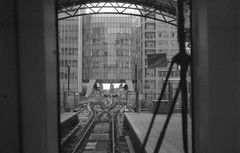 Canary Wharf Docklands Light Railway Station (Nicholas Middleton) Tags: blackandwhite london 35mm maco rodinal canarywharf dlr olympusom10 standdevelopment pushprocessing rpx400 docklandslightrailwaystation rolleirpx400