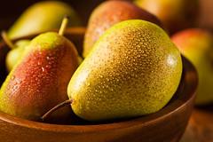 Green Organic Healthy Pears (brent.hofacker) Tags: food green yellow fruit leaf juicy healthy stem raw pears natural bright sweet vibrant tasty fresh delicious health snack vegetarian half pear organic sliced fruity ripe nutrition ingredient