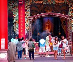 Bangkok . Quan Yin temple at the  Thian Fah Foundation Hospital (Marco Sarli) Tags: life street girls red statue thailand temple lumix women chinatown arch bangkok candid pray pillars incense quanyin {vision}:{text}=0601 {vision}:{outdoor}=0729