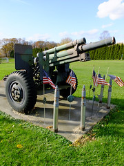 (Shane Henderson) Tags: old blue autumn trees sky shells green fall clouds gun shadows wheels rusty worn cannon artillery weathered americanflags warmemorial distressed hannahstown howitzer jeffersontownship americanlegionpost683