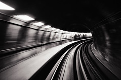 Speed (. Jianwei .) Tags: bw motion lines vancouver train subway curves rail slowshutter skytrain nex kemily nex6
