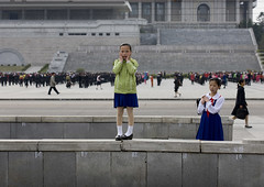 FILLETTES NORD COREENNES A PYONGYANG, COREE DU NORD (Eric Lafforgue Photography) Tags: life voyage street travel girls color colour horizontal children kid asia child streetscene asie jupe dailylife rue 2008 enfant couleur northkorea gosse ideology axisofevil pyongyang eastasia dprk juche lookingatcamera coleur viequotidienne scenederue dictature democraticpeoplesrepublicofkorea peopleinthebackground koreanpeninsula juchesocialistrepublic coreedunord rdpc insidenorthkorea kimlilsungsquare