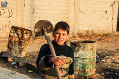 """I have to work in the orchard, I'm the eldest child and I have to help my family"" (Take a look on Syria without propaganda) Tags: syria winter children child eastern gouta wood fuel warm warmth humanity human سوريا طفلة دفء شتاء orchard old childhood innocent poor طفل حقل بستان people outdoor"