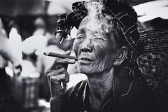 Beyond surrender~ Myanmar (~mimo~) Tags: streetphotography street portrait dark light sun blackandwhite surrender smoke cigar pao tribe ethnic woman people burma myanmar