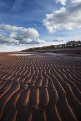 Hillside (Karl Ruston) Tags: water beach sand clouds ocean outdoor landscape cliffs northyorkshire ripples sky