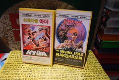 """Seoul Korea vintage Korean VHS tapes including """"Ator: The Fighting Eagle"""" on Goldstar Label - """"Sword n Sorcery"""" (moreska) Tags: seoul korea vintage korean vhs tapes ator 1982 swordandsorcery 80s invinciblebarbarian drivein pulp adventure videocassette goldstar nostalgia oldschool vcr analogue hangul graphics fonts bfilm cultmovie fx layout collectibles archive museum keepsakes t90 clamshell rentalera 1980s pop culture rok asia"""