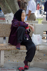 """Old lady in Hanoi with a bag from Kentucky Fried Chicken • <a style=""""font-size:0.8em;"""" href=""""http://www.flickr.com/photos/23163398@N00/33528167575/"""" target=""""_blank"""">View on Flickr</a>"""