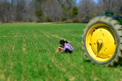 behind the wheel (TaglessKaiju) Tags: april easter wheel littlegirl egghunt easteregg johndeere tire tractor greengrass springdalefarms